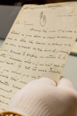 A researcher browses letters and photographs at the Bentley Historical Library.