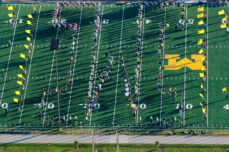 The U-M Marching Band practices on Elbel Field.
