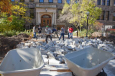 Landscape architecture students in the School of Natural Resources and Environment move concrete as they work on a class project to design and build a landscaping feature on the east side of Dana Hall.