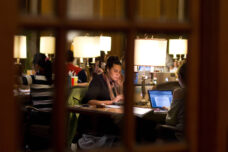 A graduate student studies in the busy lounge at the Michigan Union.