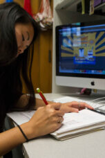 A student works on a sketch for an advertisement.