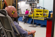 Researchers at the U-M Transporation Research Institute conduct tests to develop vehicle safety harnesses for wheelchairs.