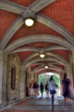 Students walk through the arch leading from South University Avenue to the Diag.