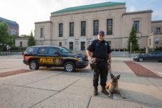 A U-M police officer  and his K-9 dog out on campus patrol.