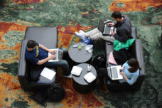 Business school students prepare for their last day of classes while sitting in the Winter Garden at the Ross School.