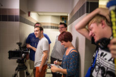 A group of students film a movie in a basement bathroom at Michigan Union.