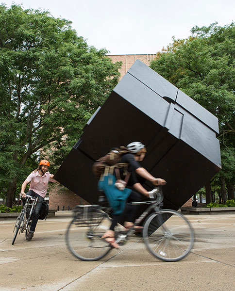 Bicyclists spin The Cube at Regents Plaza on Central Campus