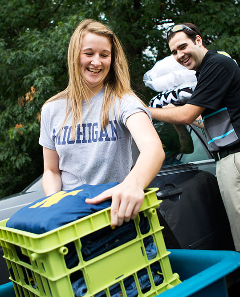 A Michigan dad helps out his freshman daughter during move-in day at Bursley Hall